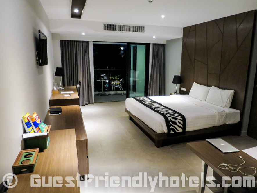 45 sq.m. Deluxe room living space opens up to a balcony in Season Five Hotel