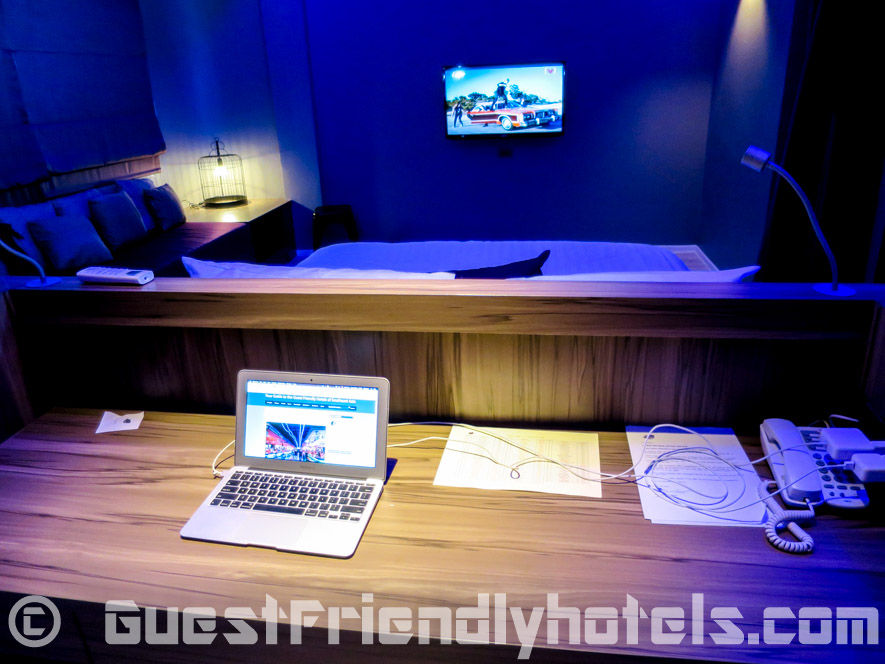 A work desk area is found behind the bed in my Superior room at the Tweet Tweet Nest Pattaya Hotel