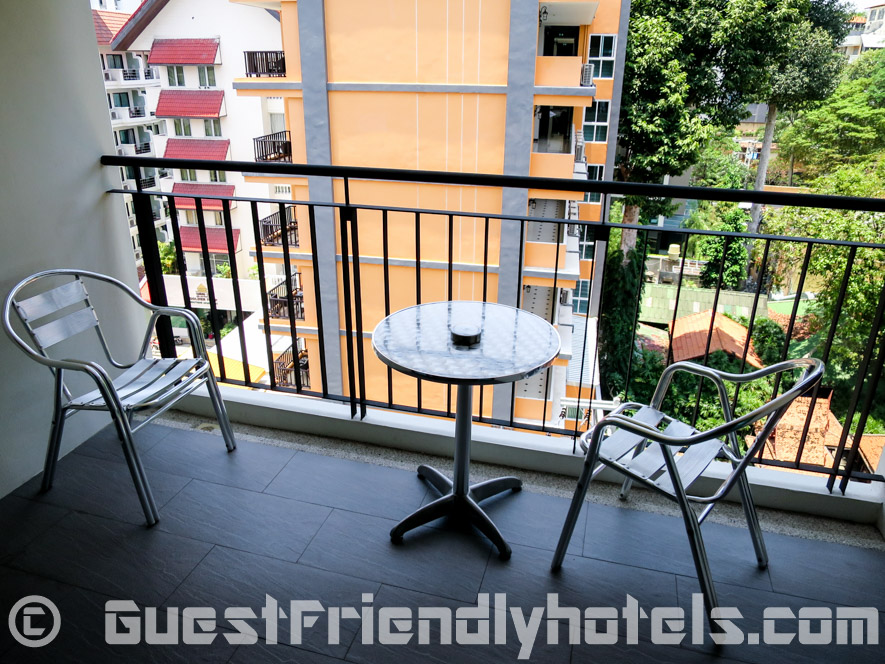 Balcony with two chairs, great for drying clothes during Songkran at Season Five Hotel