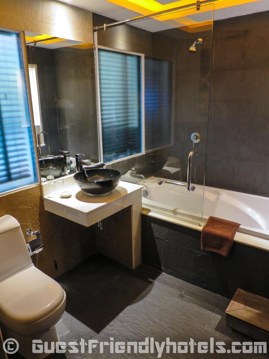 Bathroom has a shower and tub at R Mar Resort and Spa Phuket