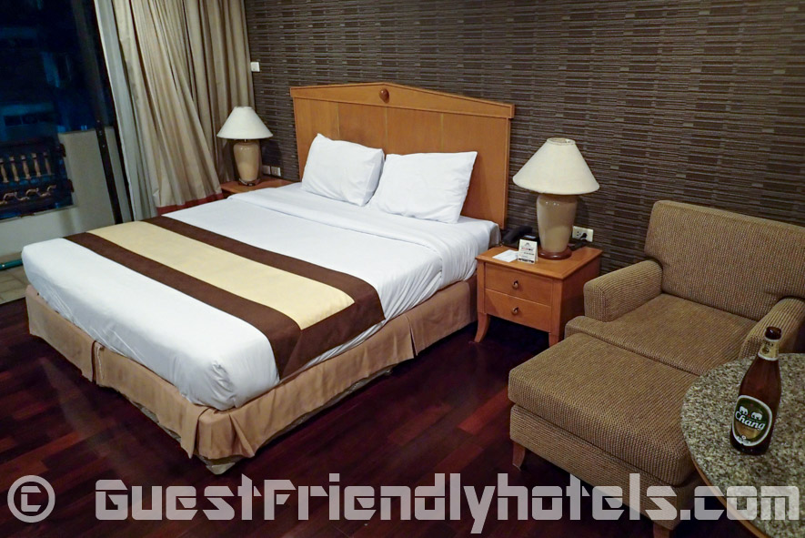 Bed and sofa inside Admiral Suites Hotel Superior Studio