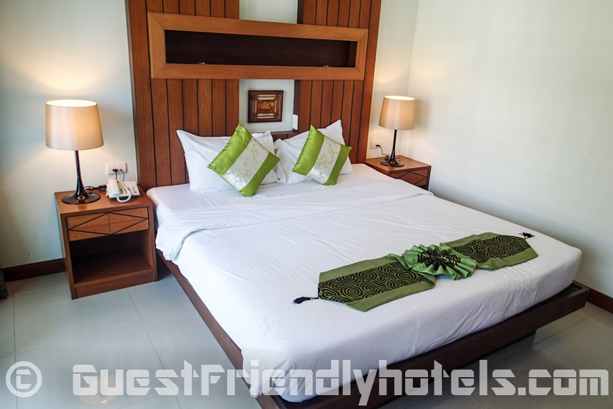 By the bed side in deluxe rooms at the Chambre Patong