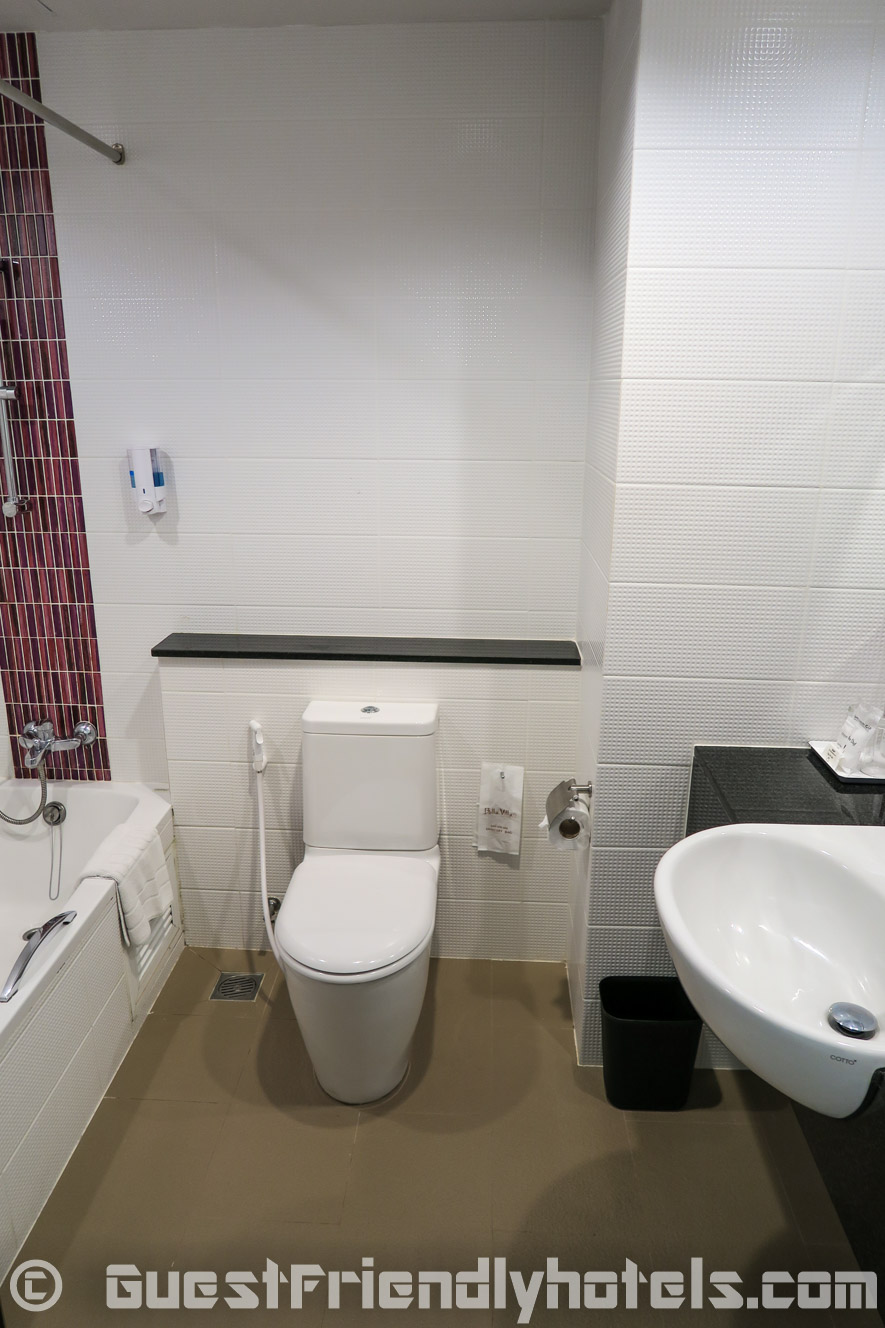 Clean bathroom with bath and shower combo at the Grand Bella Hotel Pattaya