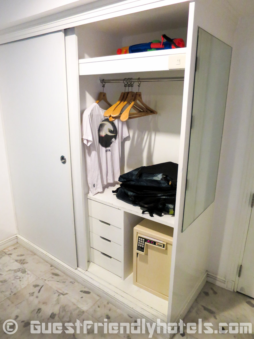 Closet space with huge safe inside standard room at Grand President Hotel in Bangkok-2