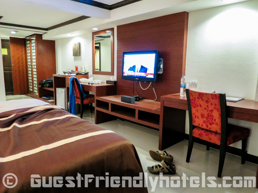 Deluxe room furnishings seen from bedside in Patong Bay Garden Resort