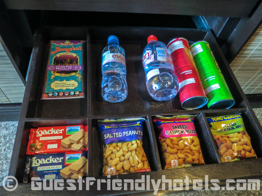 Extra minibar snacks and drinks inside room drawers at Majestic Grande Hotel Bangkok