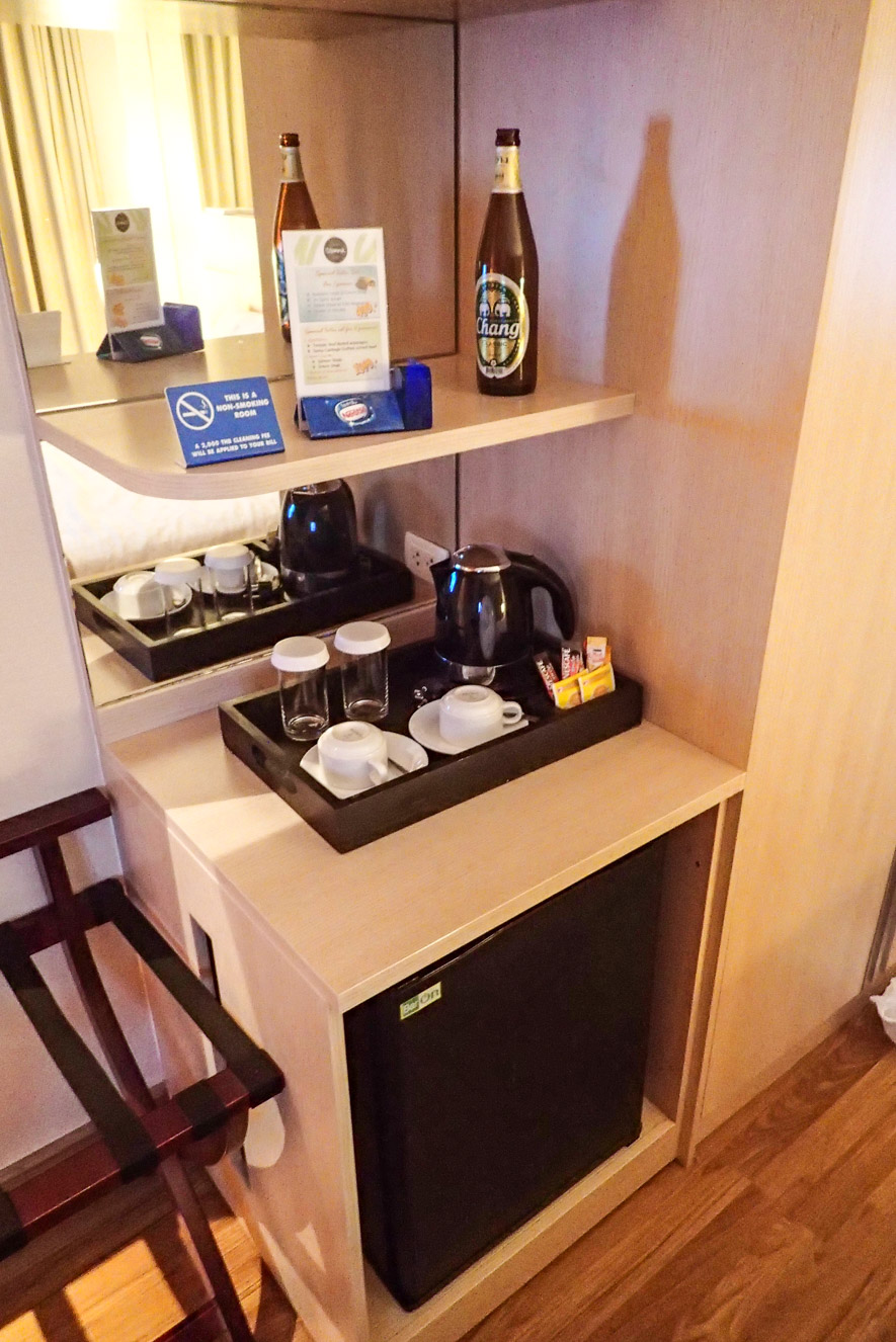 Fridge and bar area inside Superior room of Petals Inn in soi 4 nana