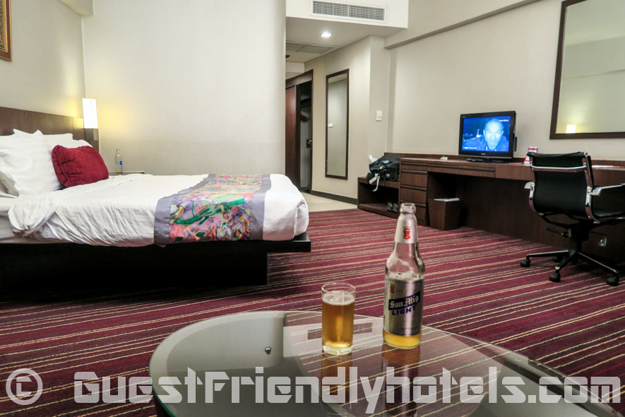 Having a beer from the couch inside superior room at the Ambassador Hotel Bangkok