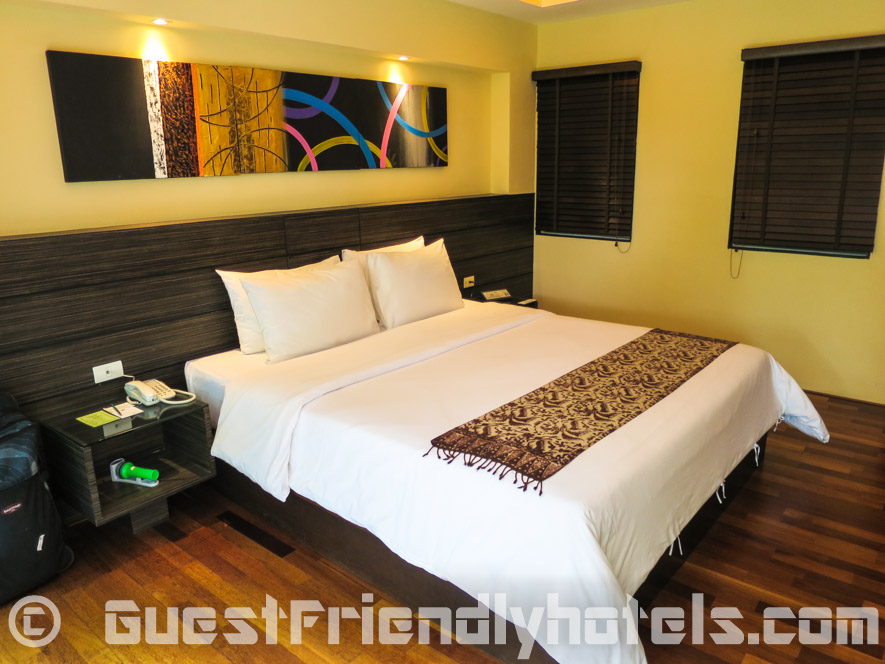 King side bed has a very comfy mattres and set of pillows in R Mar Resort and Spa