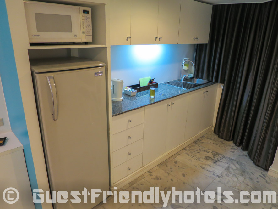 Kitchenette with big fridge in basic rooms of the Grand President Hotel Bangkok