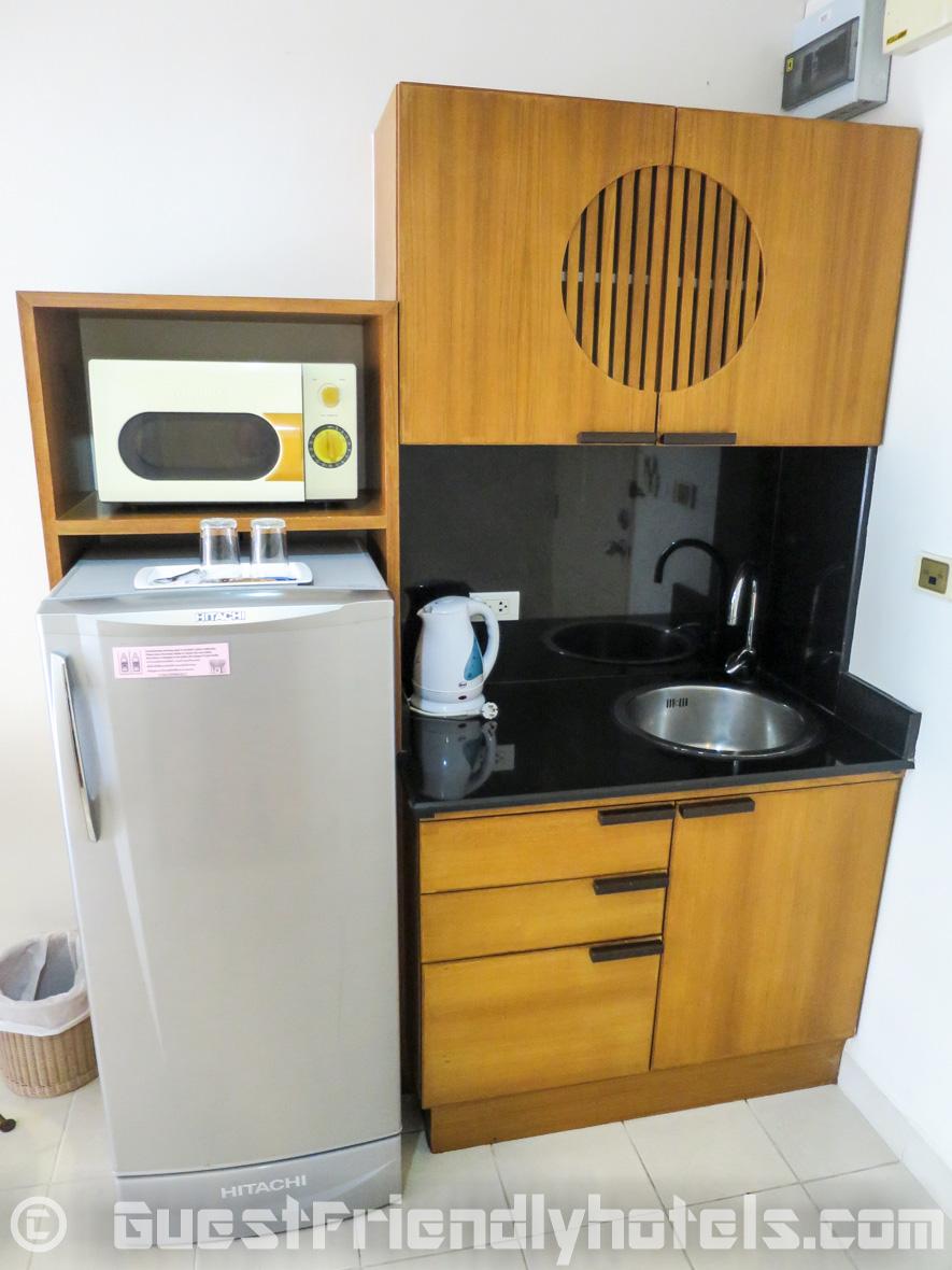 Kitchenette corner with micro wave and big fridge at Bella Villa Prima Hotel