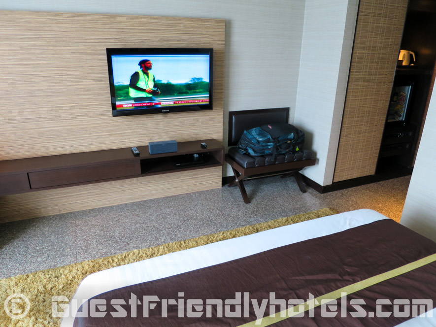Looking at the flatscreen Television from sitting on the bed at Majestic Grande Hotel Bangkok