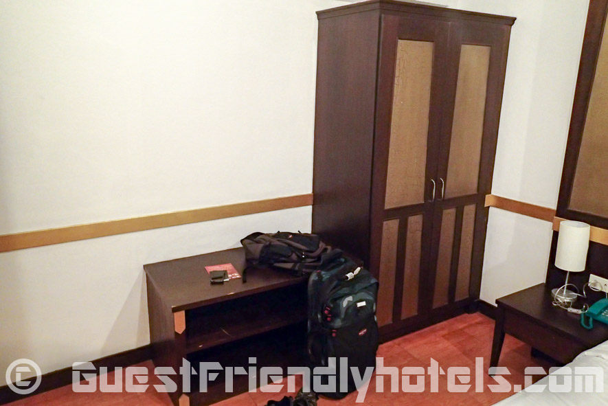 Next to the bed on one side is where you will find wardrobe and small table at the Apsara Residence