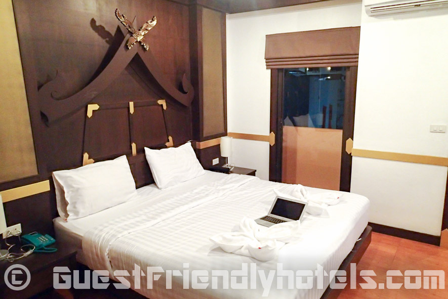 On the other side of the bed is the door leading to the small balcony in the Standard Room of the Apsara Residence