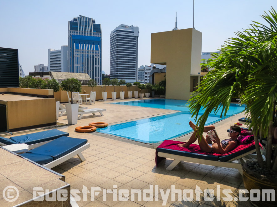 Relaxing by the pool inside Grand President Hotel Bangkok