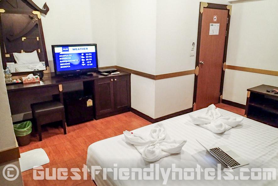 Room amenities include a flatscreen TV and a mini-bar at Aspara Residence
