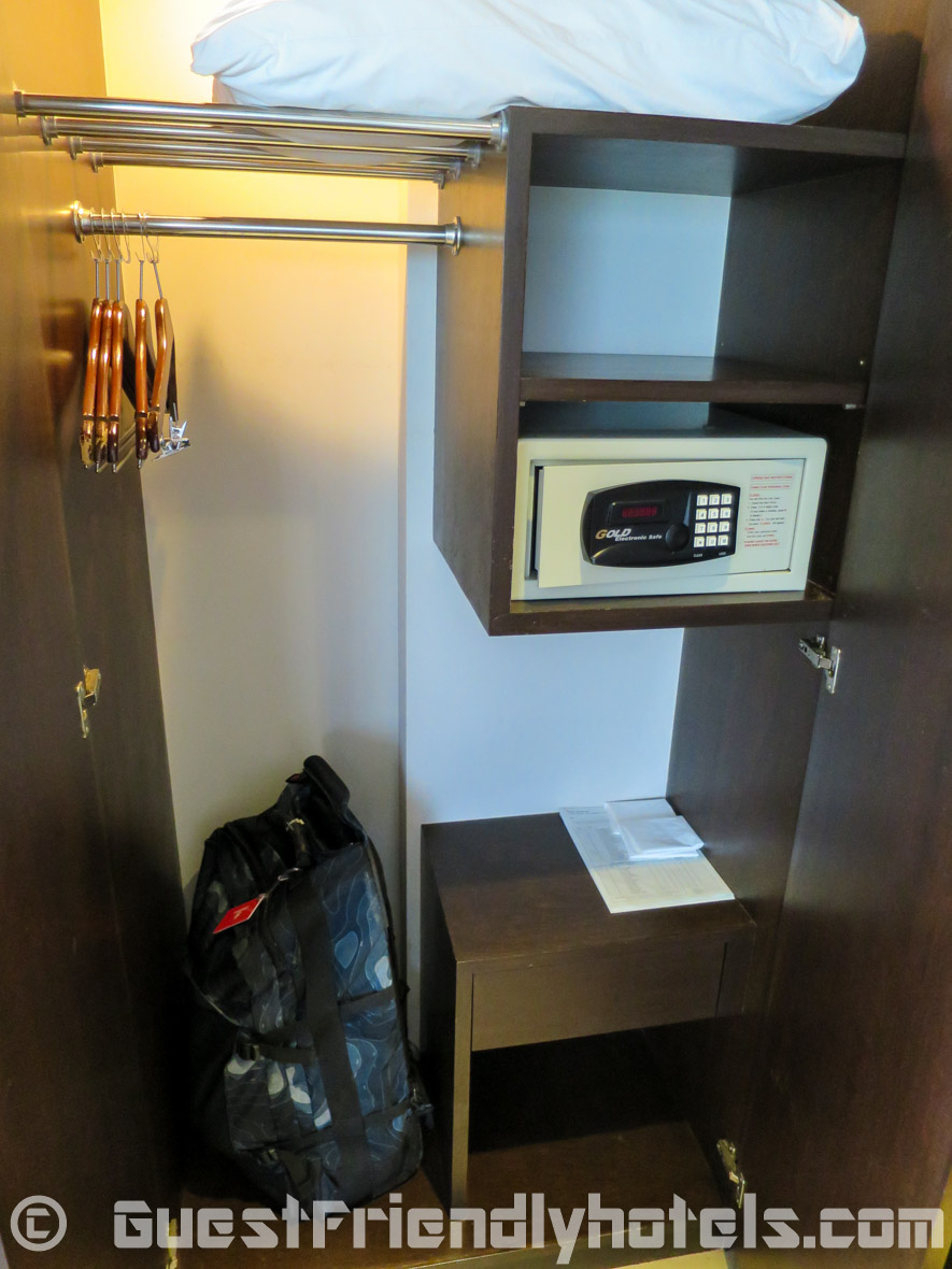 Room closet opened with safe in Dawin Bangkok Hotel