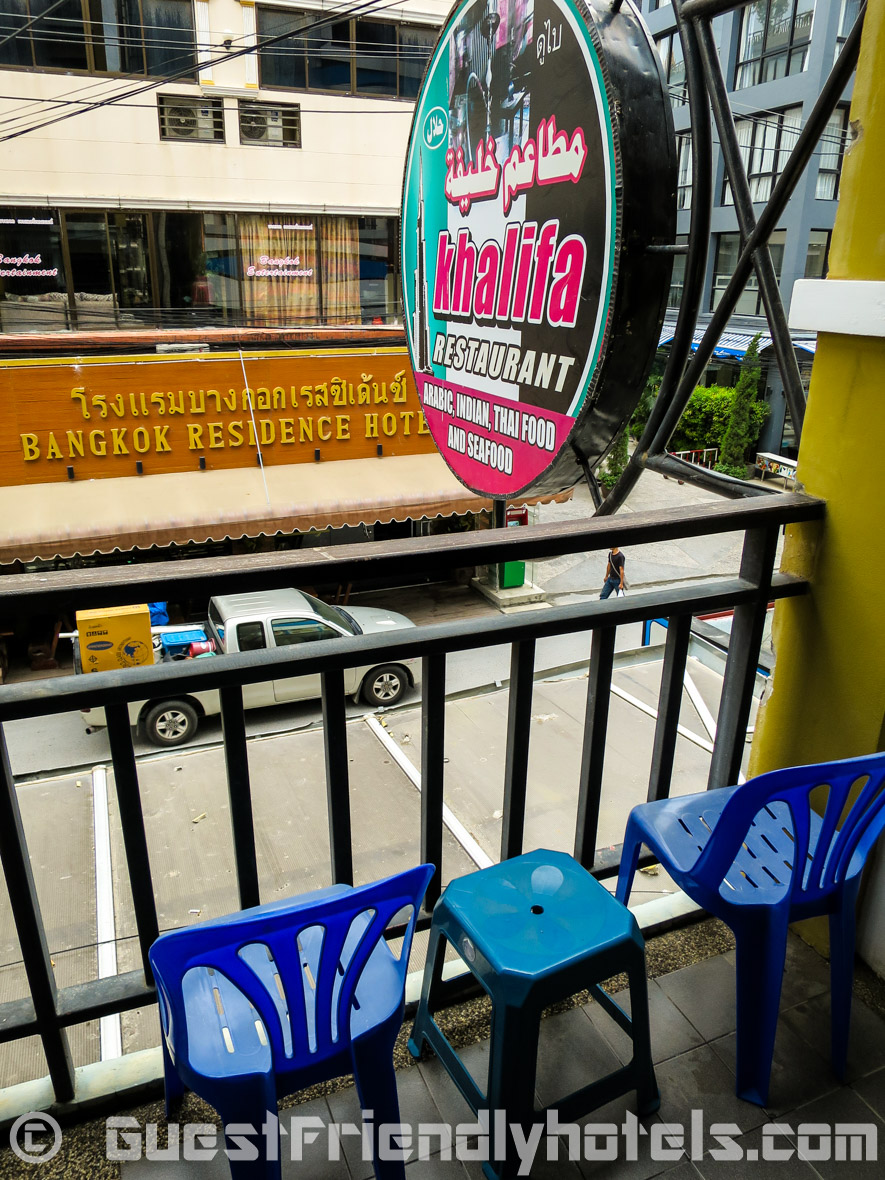 Rooms have a small balcony overlooking soi sansabai at Phil Boutique Hotel