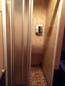 Shower in one of the rooms of EZ2 massage