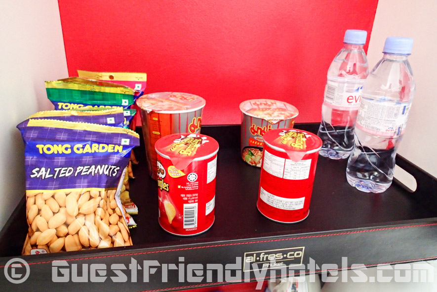 Snacks available in the mini-bar area in Alfresco Phuket Hotel