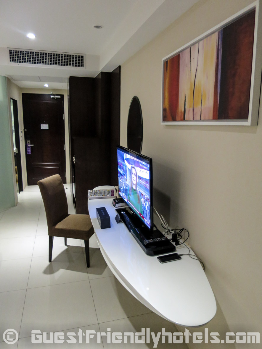 TV desk and exit inside room of Hotel Icon Bangkok