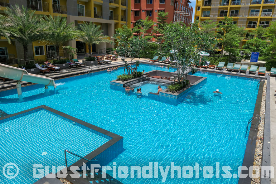 The ground level swimming pool has a small jacuzzi section in the middle at the Grand Bella Hotel in Pattaya