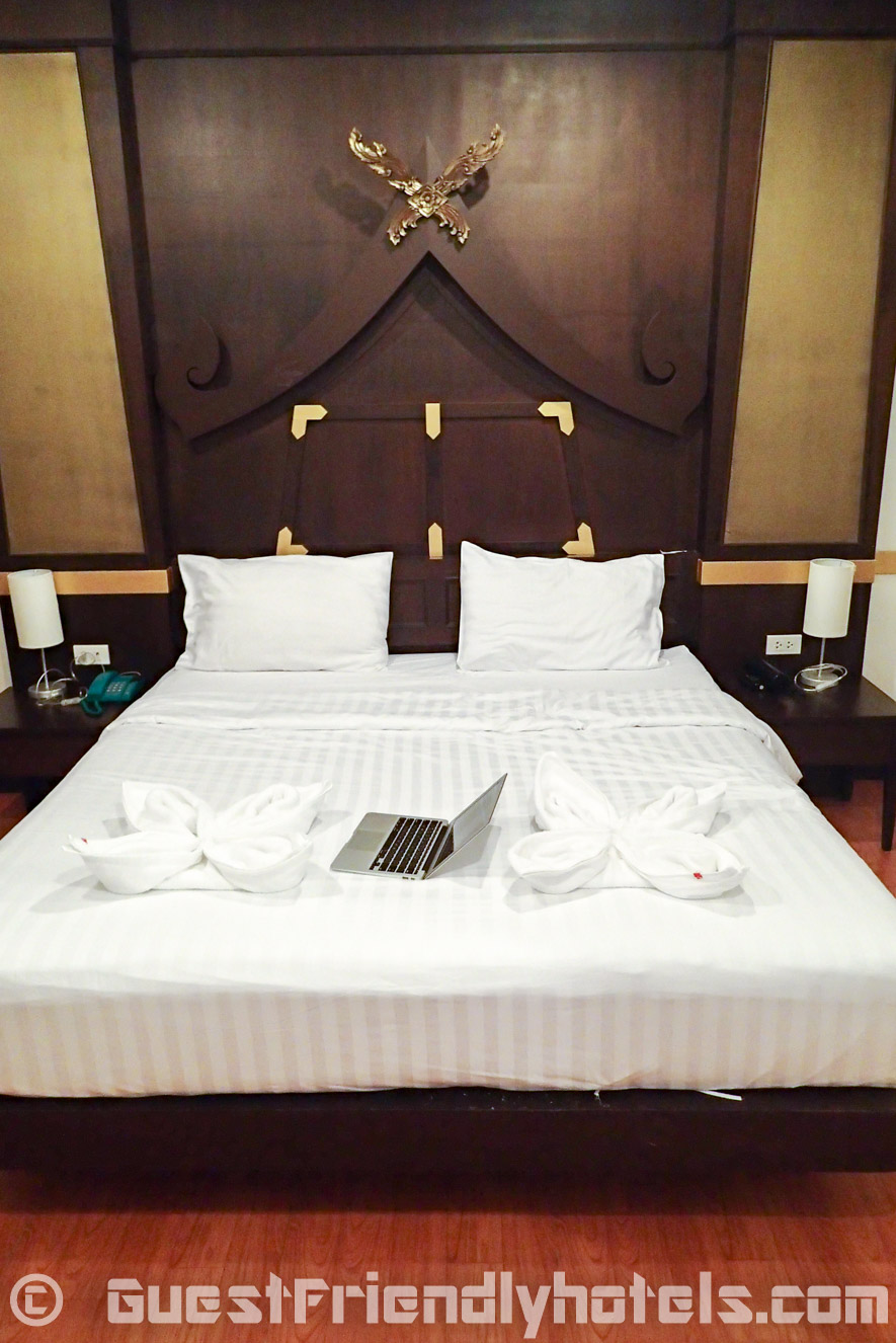 The standard room double bed inside Apsara Residence