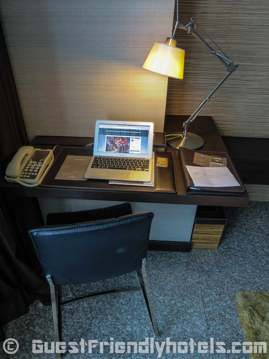 Work area with small Desk and chair inside Superior rooms in the Majestic Grande Hotel in Bangkok